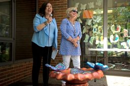 Third grade teacher Helen Hart, left, talks about the joys of working with Judy Sayre, right, on May 17 during a sculpture unveiling and surprise butterfly release at Blythe Park School in Riverside.   Alexa Rogals/Staff Photographer