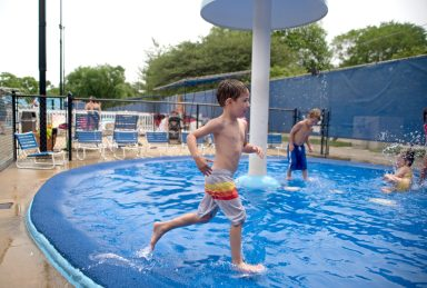 As temperatures soared into the 90s last week, kids at the Riverside Swim Club cooled off with a scamper around the zero-depth splash pad on June 14. | Alexa Rogals/Staff Photographer