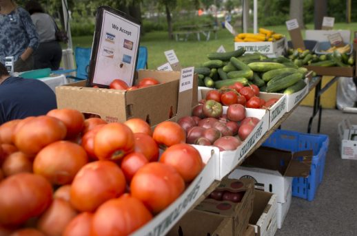 Fresh tomatoes are displayed in front of a booth for shoppers to see on Saturday, June 23, 2018, during the weekly farmers market in the Brookfield Village Hall parking lot. | Alexa Rogals/Staff Photographer