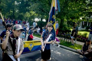 Scouts from Riverside Troop/Pack 24 march in Riverside's parade. | Alexa Rogals/Staff Photographer