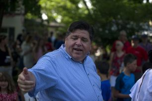 IL Democratic gov. nominee J.B. Pritzker greets attendees on July 4, during the Riverside 4th Of July Parade on Longcommon Road in Riverside. | Alexa Rogals/Staff Photographer