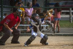 Brookfield catcher Joey Garvey catches a high pitch during a game at the Illinois District 9 Little League Baseball Tournament at Kiwanis Park. (Alexa Rogals/Staff Photographer)