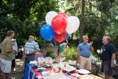 Attendees mingle in the backyard during a campaign rally for write-in candidate Justin Hanson on Aug. 11, in LaGrange. | Alexa Rogals/Staff Photographer