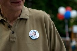 Supporters wear pins with Justin Hanson's face on Aug. 11, in LaGrange. | Alexa Rogals/Staff Photographer