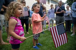 Children hold up American Flags on Aug. 11, during a campaign rally in LaGrange. | Alexa Rogals/Staff Photographer