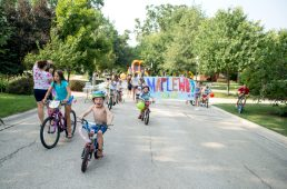 Kids parade down the street on their bikes letting the neighbors know that the party has begun on Aug. 18, during the Maplewood Road 30th annual block party in Riverside. | Alexa Rogals/Staff Photographer