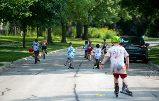 Children rollerblade and ride their bikes on Aug. 18, during the Maplewood Road 30th annual block party in Riverside. | Alexa Rogals/Staff Photographer