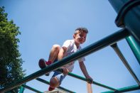 Gael Mina climbs on the monkey bars in the Hollywood playground. | Alexa Rogals/Staff Photographer