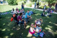 Parents and their children sit out on picnic blankets and eat lunch on Aug. 23, during a teddy bear picnic after the first day of kindergarten at Hollywood Elementary School in Brookfield. | Alexa Rogals/Staff Photographer