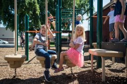 Neighbors and classmates, Harvey Troyer, left, and Emmy Johnson, sit on the playground together on Aug. 23, during a teddy bear picnic after the first day of kindergarten at Hollywood Elementary School in Brookfield. | Alexa Rogals/Staff Photographer