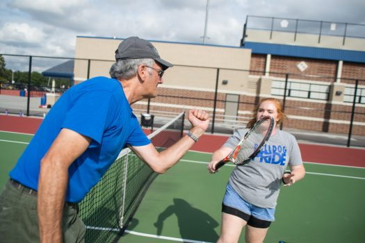 Grace Taber, a RBHS junior who plays doubles for the Bulldogs, goes through drills during a recent practice. (Alexa Rogals/Staff Photographer)