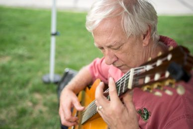 Jeff Kust plays songs for attendees on Aug. 29, during the weekly farmers market in downtown Riverside. | Alexa Rogals/Staff Photographer