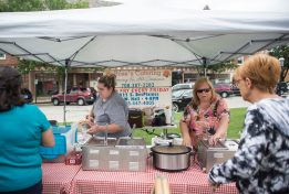 Attendees choose from soups and pulled meat at Rose's Catering stand on Aug. 29, during the weekly farmers market in downtown Riverside.   Alexa Rogals/Staff Photographer