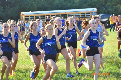 Led by senior Tara Janney, center, the RBHS cross country team gets off to a fast start at the RB Invite at Sundown Meadows. (Photo by John Keen)