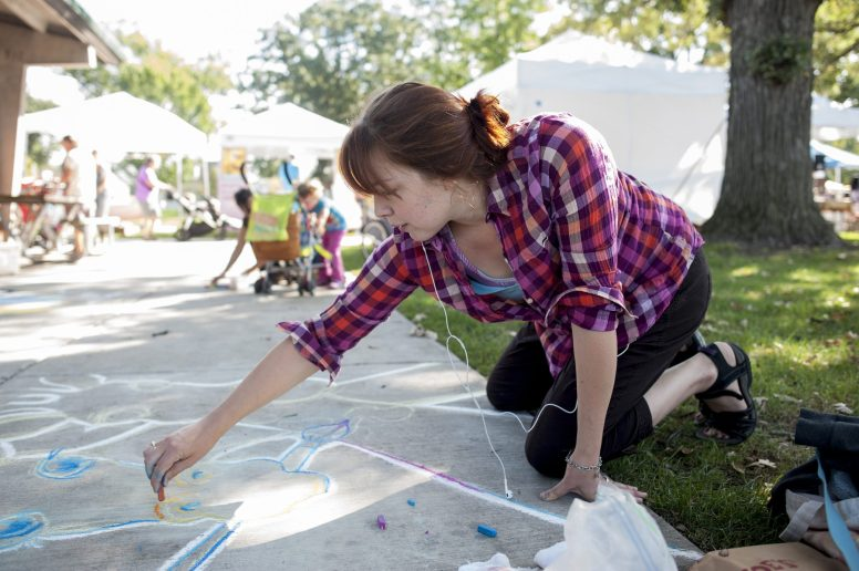 Jen Downing participates in the chalk art contest during the Brookfield Fine Arts Festival in 2015. | FILE