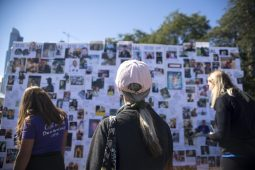 Participants take a moment to view the memorial wall on Sept. 22, during the American Foundation for Suicide Prevention Out of the Darkness Walk at Grant Park in Chicago. | Alexa Rogals/Staff Photographer