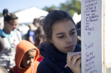 """Participants add to the """"Why I Walk"""" wall on Sept. 22, during the American Foundation for Suicide Prevention Out of the Darkness Walk at Grant Park in Chicago. 