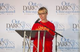 Alyssa Relyea, American Foundation for Suicide Prevention Illinois Chapter Board Member, speaks to participants on Sept. 22, 2018, during the American Foundation for Suicide Prevention Out of the Darkness Walk at Grant Park in Chicago. | Alexa Rogals/Staff Photographer