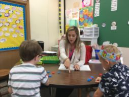 Sydni Dames, a first-grade teacher, helps her students with English on Sept. 22, at Congress Park School in Brookfield. | Photo by Bob Skolnik