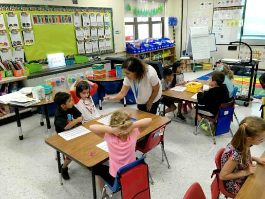 First grade teacher Jessica Valverde goes over Spanish words with her students on Sept. 22, at Congress Park School in Brookfield. | Photo by Bob Skolnik