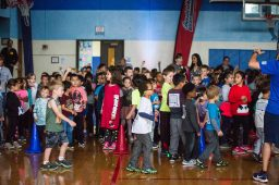 Students line up and prepare to begin running on Oct. 5, during the walkathon inside the gymnasium at Congress Park School in Brookfield. | Alexa Rogals/Staff Photographer