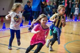 A group races around the track on Oct. 5, during the walkathon inside the gymnasium at Congress Park School in Brookfield. | Alexa Rogals/Staff Photographer