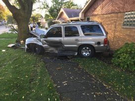 A Cadillac Escalade believed to be involved in a burglary on Brookfield south end struck another vehicle at the intersection of Maple and Garfield avenues while trying to flee the area and then left the roadway, struck a tree and came to rest inches away from a house. (Photo courtesy of the Brookfield Police Department)