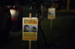 Posters displaying the mugshot of six-grade language arts teacher Andrew Rodriguez are lightly scattered outside of the building and on fences on Oct. 22, during a District 103 School Board meeting at George Washington Middle School in Lyons. | ALEXA ROGALS/Staff Photographer