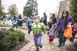Children dressed in costumes run around the area during the annual Monsters on Mainstreet trick-or-treating event on Oct. 27.   ALEXA ROGALS/Staff Photographer