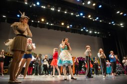 Students warm up on stage on Nov. 3, during dress rehearsals for Alice In Wonderland at Riverside Brookfield High School. | ALEXA ROGALS/Staff Photographer