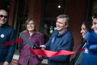 Kit Ketchmark, the director of the Brookfield Historical Society, cuts the ribbon and officially opens the museum on Nov. 3, during the Founder's Day event at Grossdale Station in Brookfield. | ALEXA ROGALS/Staff Photographer