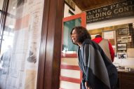 Elizabeth Hernandez, IL State Rep for the 24th district, looks at historical photos and maps inside the museum on Nov. 3, during the Founder's Day event at Grossdale Station in Brookfield. | ALEXA ROGALS/Staff Photographer
