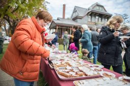 Shannon Heller, of Brookfield, slices up pastries donated from Mary's Morning Mix Up on Nov. 3, during the Founder's Day event at Grossdale Station in Brookfield. | ALEXA ROGALS/Staff Photographer