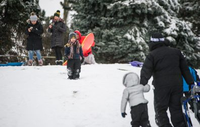 Dante Jimenez, 5, of Riverside, waits for his family at the top of the hill on Nov. 26, at the North Riverside Village Commons sledding hill on Des Plaines Avenue in North Riverside. | Alexa Rogals/Staff Photographer
