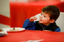 Christian Larkin, 3, of Brookfield, eats the icing off his recently decorated cookie on Dec. 1 at Village Hall as part of Brookfield's Holiday Celebration. | Photo by Sarah Minor