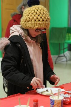 Aubri Swiatnicki, 10, of Westmont, decorates a cookie on Dec. 1 at Village Hall as part of Brookfield's Holiday Celebration. | Photo by Sarah Minor