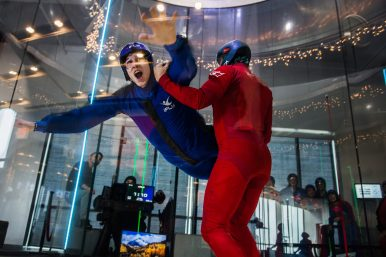 RBHS junior Jack Stivers is guided by an instructor during a physics lesson on gravity, resistance and terminal velocity at an indoor skydiving facility in Naperville last week. | Sebastian Hidalgo/Contributor