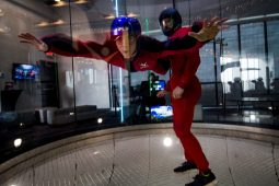 Alex Gaber, a junior at Riverside-Brookfield High School, is guided by an iFly instructor during a demonstration. | Sebastian Hidalgo/Contributor