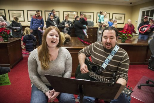Jessica Rovner, left, of Willowbrook, and Mike Rovner, of Brookfield, play holiday songs on Dec. 7, as families wait to take their photos with Santa Claus during the 44th annual Chamber of Commerce Holiday Stroll in downtown Riverside. | Alexa Rogals/Staff Photographer