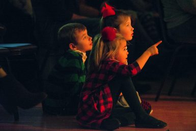 "Children watch the show from the audience on Dec. 15, during the Riverside Children's Theater Guild ""Saving Christmas"" original musical at Township Hall in Riverside. 