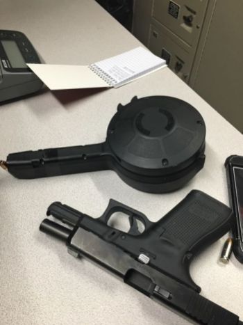 Riverside police recovered this Glock 19 handgun with a 53-round drum-style magazine in Swan Pond Park near the crash scene in August. (Photo courtesy of the Riverside Police Department)