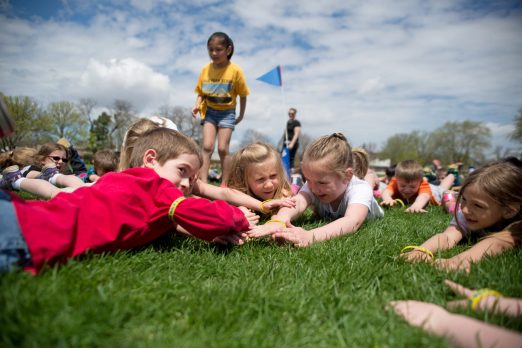 irst graders from Brook Park School participate in different exercises on the soccer field on May 4, during a Walkathon at Vena Park in La Grange Park. | Alexa Rogals/Staff Photographer