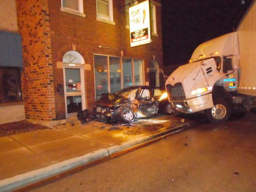 The driver of a Kia sedan pinned against the wall of an Ogden Avenue restaurant by the jackknifed semi-tractor trailer sustained only minor injuries, according to police. (Photo courtesy of the Brookfield Police Department)