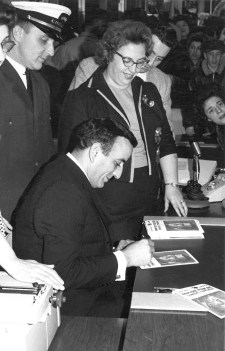 Tony Bennett signs autographs at the Jan. 15, 1963 event at Marshall Savings and Loan in Riverside. | Photo courtesy Liz Faron collection