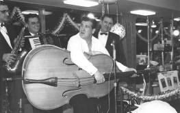 Shecky Greene mugs for the audience packed into the lobby of Marshall Savings and Loan during his appearance as part of the thrift's 100 Million Dollar-versary on Jan. 9, 1963. | Photo courtesy Liz Faron collection