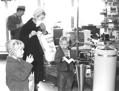 Customers attending Marshall Savings' 100 Million Dollar-versary in January 1963 enjoy treats and look over the promotional gifts for opening new accounts and door prizes. Photo courtesy Liz Faron collection