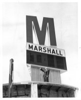 Jerome Moravec, vice president and treasurer of Marshall Savings and Loan in Riverside, gives a sense of the size of the giant 'M' and digital time-and-temperature display that was erected atop the S&L building at the corner of Harlem and Ogden. Shown as final construction was wrapping up in May 1963, installation of the sign was the climax of a building expansion campaign that'd been under way since 1957. | Photo courtesy Liz Faron collection