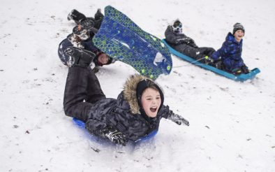 A group of kids go sledding down the hill together Jan. 19, at Swan Pond in Riverside. | ALEXA ROGALS/Staff Photographer