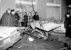 Police survey what's left of a baggage cart where someone placed a bomb between two cars in the parking lot of the Sahara North in January 1964. It was the second time in four months that a bomb had exploded there. Prospective new owner Gene Autry bailed out later that year, leaving Marshall Savings and Loan on the hook again. | Courtesy Liz Faron collection