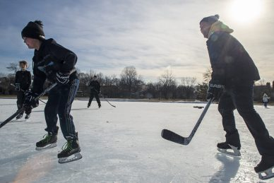Kids and adults play a hockey game together on the rink on Feb. 9, 2019, at the Big Ball Park ice rink in Riverside. | ALEXA ROGALS/Staff Photographer